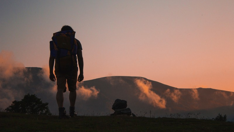 backpacker-looking-at-mountains_h.jpg